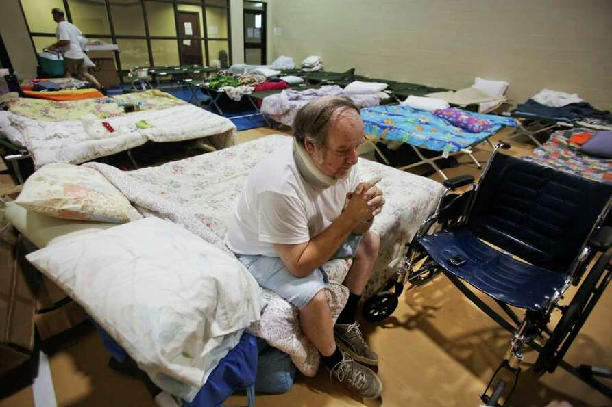 Sept. 11, 2011 | John Buchanan, of Waller County, rests on a cot at the Red Cross Shelter located in