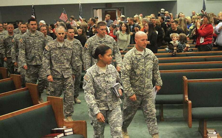 Soldiers with the Kentucky National Guard's Company A, 149th Brigade Support Battalion based in Benton, Ky. march into the sanctuary of the Benton Church of Christ Tuesday afternoon, Dec. 20, 2011 for a welcome-home ceremony after the unit returned from duty in Iraq. (AP Photo/The Paducah Sun, John Wright) Photo: John Wright / PADUCAH SUN