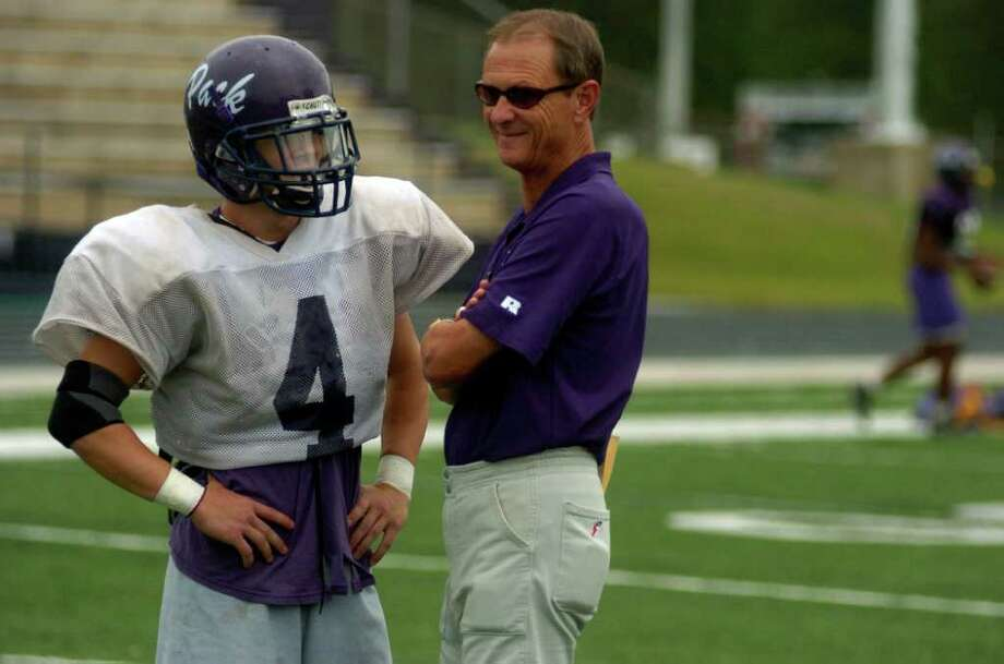 "Lufkin High School football coach John Outlaw talks with player Marcus Rains, a senior during practice Friday, September 30, 2005. ""The kids really need this,""  Outlaw said. Johnny Hanson Chronicle Photo: Johnny Hanson / Contract"