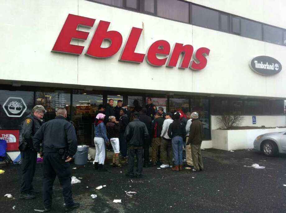 Bridgeport police officers stand by as a line waits to purchase Air Jordan Concords, Friday, Dec. 23, 2011. Photo: Tom Cleary