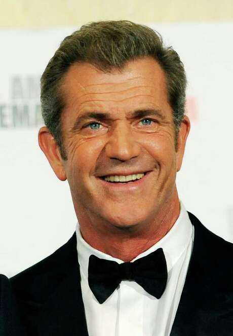 "FILE - In this Oct. 14, 2011 file photo, Mel Gibson poses at the 25th American Cinematheque Award benefit gala honoring actor Robert Downey Jr., in Beverly Hills, Calif. Gibson has finalized his divorce from his wife of 28 years. Attorneys for the Oscar winner and his ex-wife appeared briefly in a Los Angeles courthouse Friday, Dec. 23, 2011, to submit a proposed judgment, which a judge signed hours later. Robyn Gibson filed for divorce in April 2009, just months before Gibson's then-girlfriend gave birth to a daughter. The ""Braveheart"" star indicated in his own court filings that the couple separated in 2006. (AP Photo/Chris Pizzello, File) Photo: Chris Pizzello / AP2011"