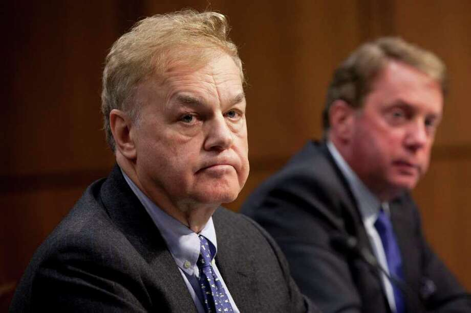 James Giddens, trustee of the liquidation of MF Global Holdings Ltd., left, and Terrence Duffy, executive chairman of CME Group Inc., listen during a Senate Agriculture Committee hearing in Washington, D.C., U.S., on Tuesday, Dec. 13, 2011. Three of MF Global Holdings Ltd.'s top executives said they didn't know what happened to as much as $1.2 billion in client funds that went missing in the days before the New York-based brokerage filed for bankruptcy. Photographer: Andrew Harrer/Bloomberg *** Local Caption *** James Giddens; Terrence Duffy Photo: Andrew Harrer / © 2011 Bloomberg Finance LP