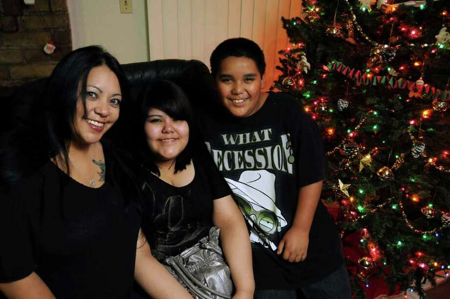 Marcie Castillo and her children Selena, 16, and Christian, 11, reside in Humble. Selena had an urgent need for medical care, and her family used up their Christmas funds to cover the expenses related to her recovery. Photo: Dave Rossman / © 2011 Dave Rossman