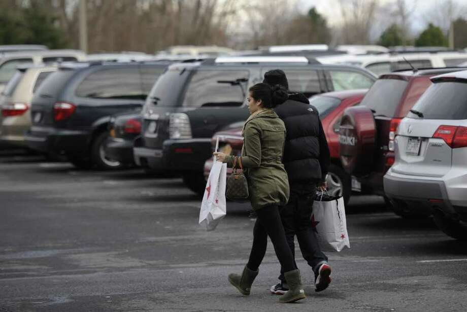 The parking lots of Colonie Center are full and shoppers are still catching up with last minute shopping Dec. 23, 2011 in Colonie, N.Y.    (Skip Dickstein/Times Union) Photo: Skip Dickstein / 2011