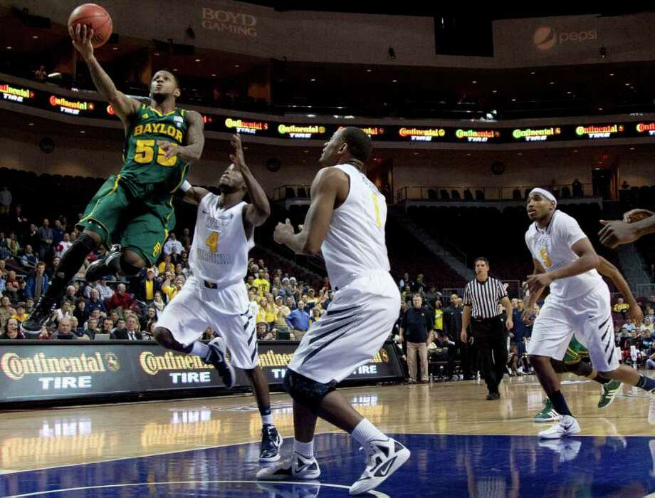 JULIE JACOBSON: ASSOCIATED PRESS AIR BEAR: Baylor's Pierre Jackson, left, goes up for a shot against West Virginia's Jabarie Hinds, center, and Kevin Jones on Friday night in the Las Vegas Classic title game. Photo: Julie Jacobson / AP