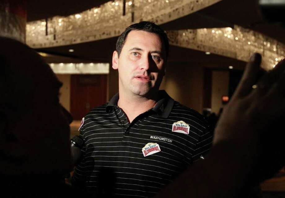 The Washington Huskies head coach Steve Sarkisian takes questions from media as the football team arrives in San Antonio at the Marriott Rivercenter on Friday, Dec. 23, 2011. The Huskies will play Baylor in the 2011 Valero Alamo Bowl on Dec. 29. Photo: Kin Man Hui, ~ / San Antonio Express-News