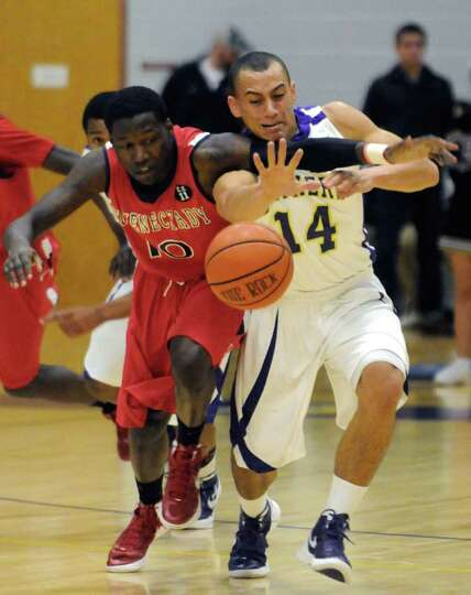 Schenectady's Jallah Tarver and CBA's Chaz Lott battle for the ball during their boy's high school b