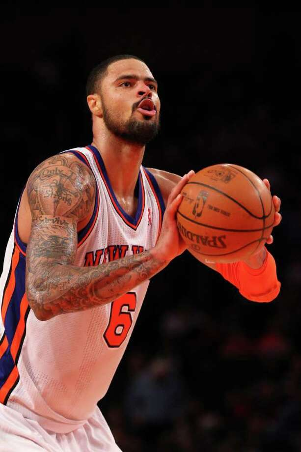 NEW YORK, NY - DECEMBER 21:  Tyson Chandler #6 of the New York Knicks shoots a foul shot against the New Jersey Nets during their pre season game  at Madison Square Garden on December 21, 2011 in New York City.  NOTE TO USER: User expressly acknowledges and agrees that, by downloading and or using this photograph, User is consenting to the terms and conditions of the Getty Images License Agreement.  (Photo by Al Bello/Getty Images) Photo: Al Bello / 2011 Getty Images