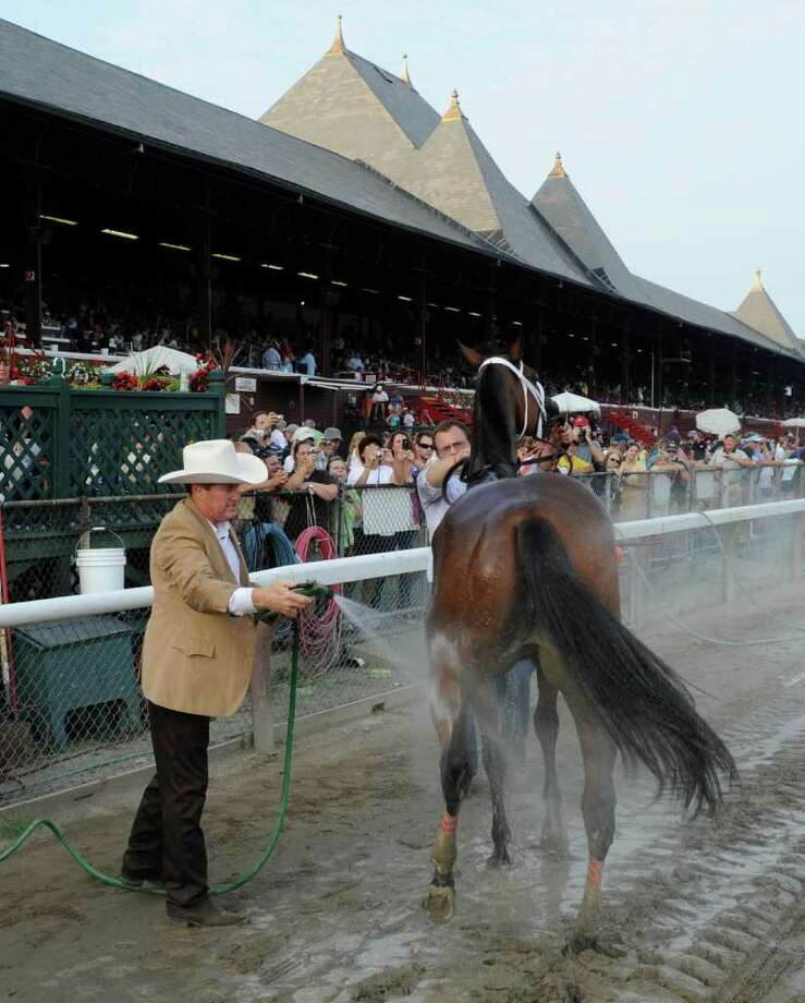 Trainer Larry Jones give Havre de Grace a cooling bath after she as won the 58th running of The Woodward at the Saratoga Race Course in Saratoga Springs, N.Y. Sept 3, 2011.    (Skip Dickstein / Times Union) Photo: SKIP DICKSTEIN