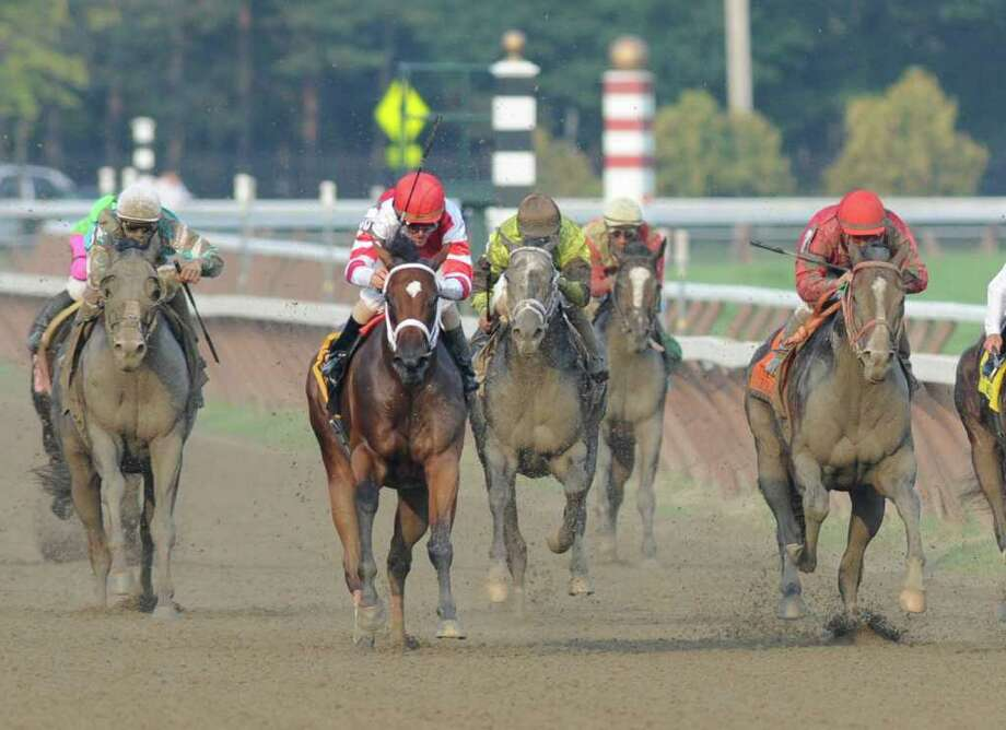 Havre de Grace, second from left,  ridden by Ramon Dominguez is challenged by Giant Oak, right,  as she wins the 58th running of The Woodward at the Saratoga Race Course in Saratoga Springs, N.Y. Sept 3, 2011.    Photo Courtesy of Erika Dickstein Photo: SKIP DICKSTEIN