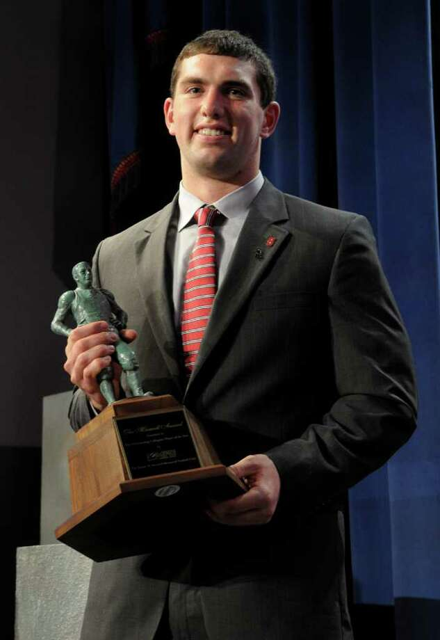 Stanford's Andrew Luck holds the Maxwell Award given to the college player of the year during the College Football Awards show in Lake Buena Vista, Fla., Thursday, Dec. 8, 2011. (AP Photo/Phelan M. Ebenhack) Photo: Phelan M. Ebenhack / FR121174 AP