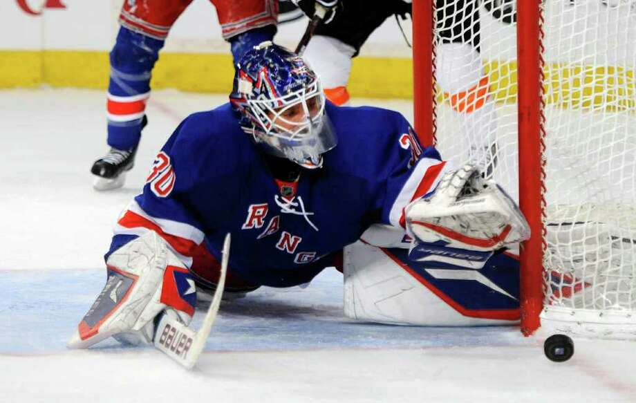 New York Rangers goalie Henrik Lundqvist makes a save against the Philadelphia Flyers in the third period of an NHL hockey game at New York's Madison Square Garden, Friday, Dec. 23, 2011. Lundqvist had 28 saves as the Rangers won 4-2. (AP Photo/Henny Ray Abrams) Photo: Henny Ray Abrams