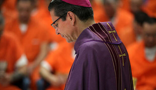 San Antonio Archbishop Gustavo Garcia-Siller prays after celebrating Mass inside Bexar County Jail.  Friday, Dec. 23, 2011. Photo Bob Owen/rowen@express-news.net