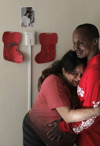 Annette Thimsen and Kelano Gee embrace in the home they are moving into in the Sunnydale project. Photo: Michael Macor, The Chronicle