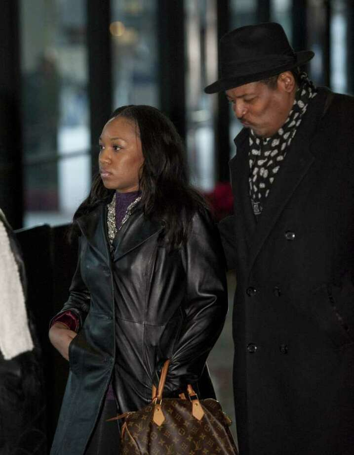 Stacee Hurd, left, wife of former Chicago Bears wide receiver Sam Hurd, leaves federal court after her husband's bond hearing on Friday, Dec. 16, 2011, in Chicago. Hurd, who was arrested Wednesday night after allegedly telling an undercover agent he was interested in buying five to 10 kilograms of cocaine and 1,000 pounds of marijuana per week to distribute in the Chicago area, was released Friday after posting $100,000 bond. Photo: AP