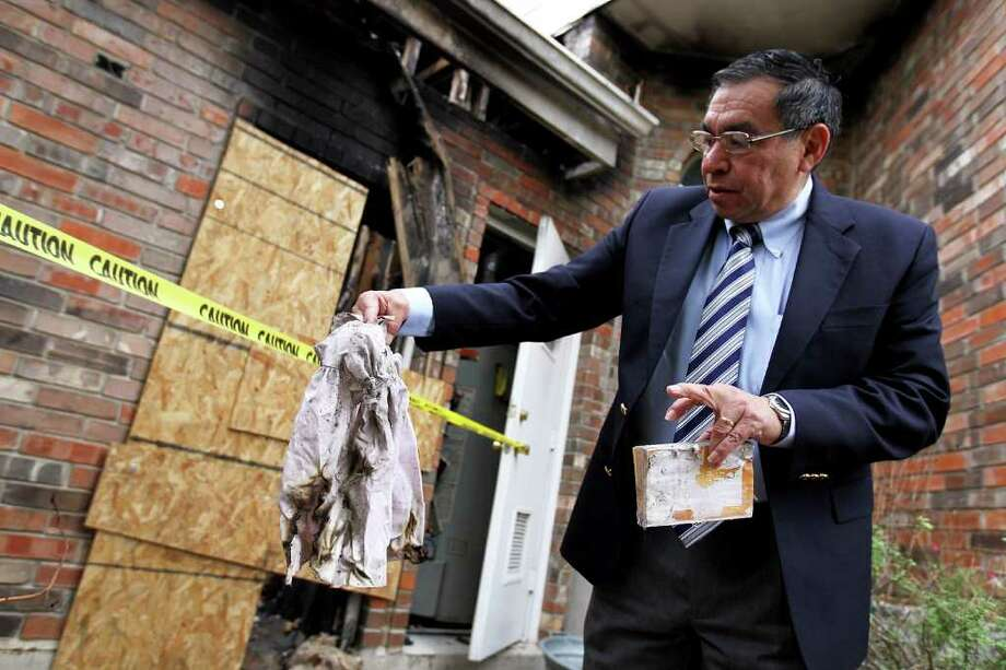 JENNIFER WHITNEY PHOTOS : NEW YORK TIMES DEVASTATED: Ricardo Sanchez finds a childhood dress of one of his daughters at his home after it was damaged by a fire in San Antonio on Veterans Day. The retired former top commander in Iraq has had a spate of personal ordeals. Photo: JENNIFER WHITNEY / NYTNS