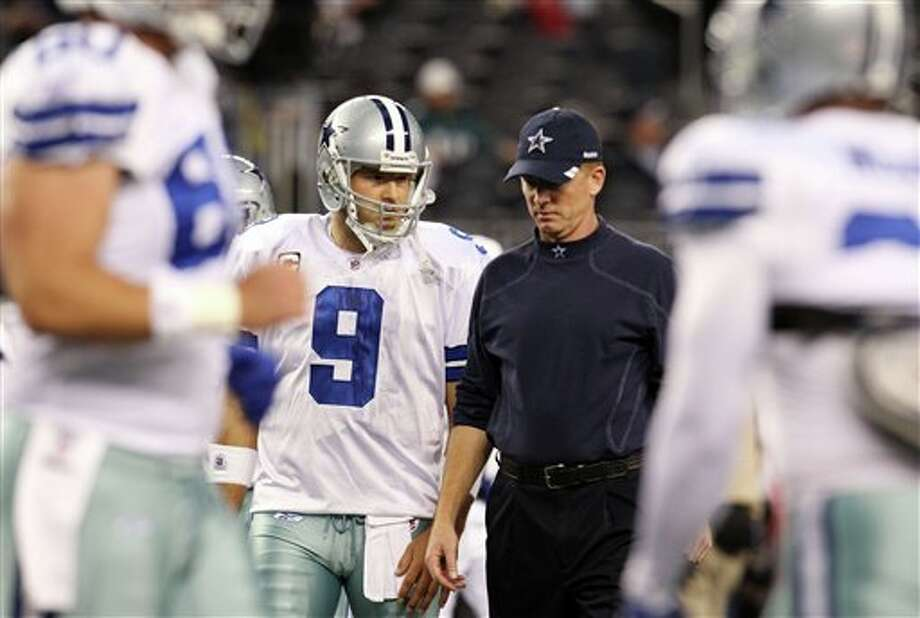 Cowboys quarterback Tony Romo and head coach Jason Garrett talk before Saturday's game against the  Eagles. (AP Photo/Sharon Ellman)