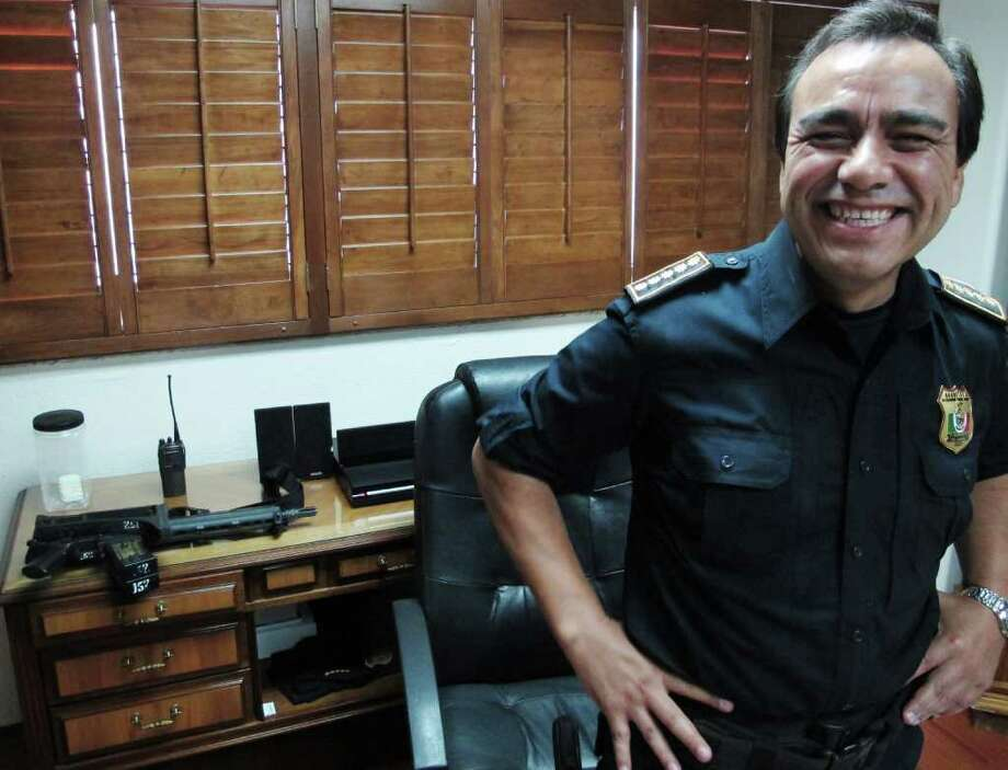 Julian Leyzaola, police chief of Juarez, smiles during an interview with foreign media in his office in Juarez, Mexico, Tuesday June 7, 2011. The new police chief in Mexico's deadliest city says bringing crime down and cleaning up the police force should be much easier than it was in Tijuana, where he spent three years as the top cop. Photo: AP
