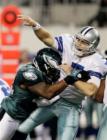 Dallas Cowboys quarterback Stephen McGee (7) is hit by Philadelphia Eagles defensive end Trent Cole (58) during the first half of an NFL football game Saturday, Dec. 24, 2011, in Arlington, Texas. (AP Photo/Brandon Wade) Photo: Brandon Wade, Associated Press / FR168019 AP
