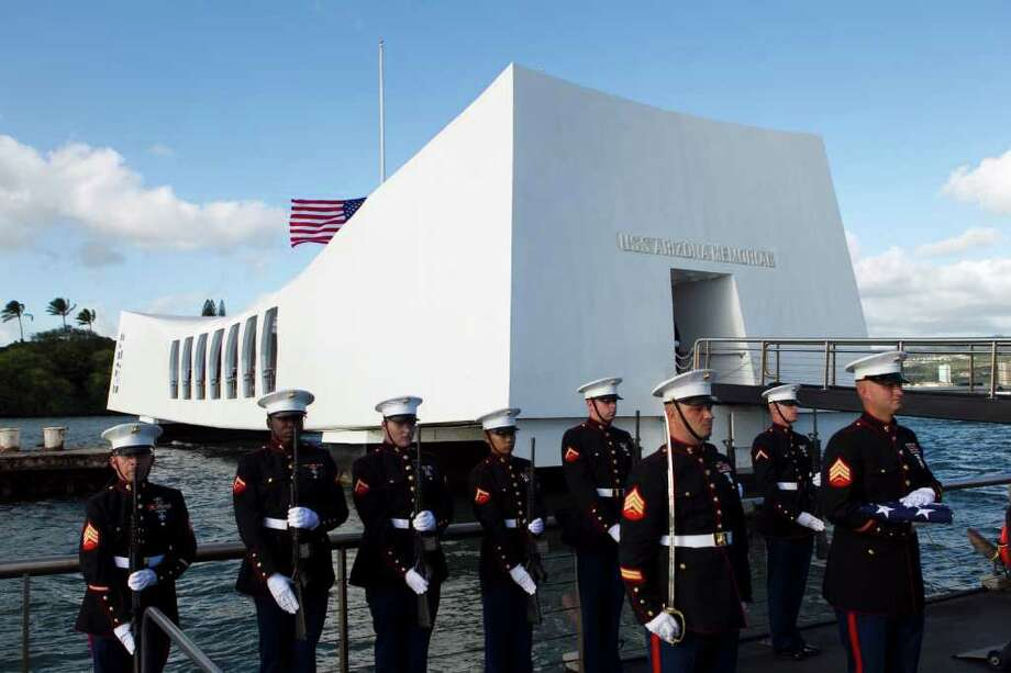 US Marines stand at attention as the family of  Private First Class Frank R. Cabiness arrive at a ceremony to have his ashes interred inside the USS Arizona, Friday, Dec. 23, 2011 in Honolulu.  Cabiness, who was aboard the USS Arizona when the Japanese attacked, was blown from the decks when the ship's magazine exploded.  Cabiness, who died in 2002, is the second Marine to be interred within the USS Arizona.  (AP Photo/Marco Garcia) Photo: Marco Garcia / 2011