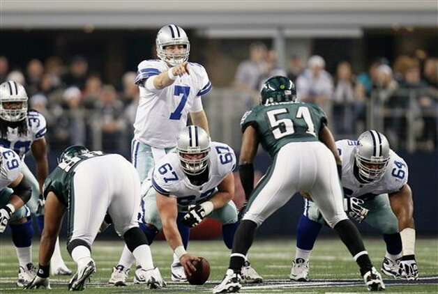Dallas Cowboys quarterback Stephen McGee (7) line up behind center Phil Costa (67) during the first half of an NFL football game Saturday, Dec. 24, 2011, in Arlington, Texas. (AP Photo/Brandon Wade) Photo: Brandon Wade, Associated Press / FR168019 AP