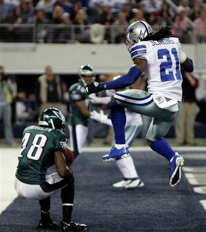 Philadelphia Eagles wide receiver Jeremy Maclin (18) catches a touchdown pass in front of Dallas Cowboys cornerback Mike Jenkins (21) during the first half of an NFL football game Saturday, Dec. 24, 2011, in Arlington, Texas. (AP Photo/Brandon Wade) Photo: Brandon Wade, Associated Press / FR168019 AP
