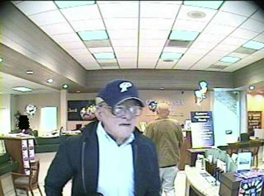 """FILE - This undated file image provided by the FBI shows a suspect, nicknamed the """"Geezer Bandit"""" in the process of robbing a bank April 20, 2010. The FBI says an elderly-looking bank robber dubbed the """"Geezer Bandit"""" may not be as old as he appears. FBI spokeswoman Laura Eimiller says the robber believed to be responsible for 16 holdups in California may be wearing an elaborate costume.  (AP Photo/FBI, File) Photo: Anonymous / AP2010"""