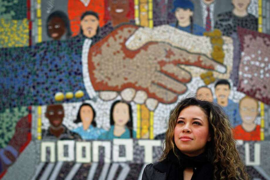 MICHAEL PAULSEN : CHRONICLE FACING FUTURE: Gaby Valladares could well be one of the young faces depicted in the mural at the Houston Alumni and Youth Center. She spent most of her teen years as a foster child, and at 27 now works as a CPS caseworker helping foster children become productive adults. Photo: Michael Paulsen / © 2011 Houston Chronicle