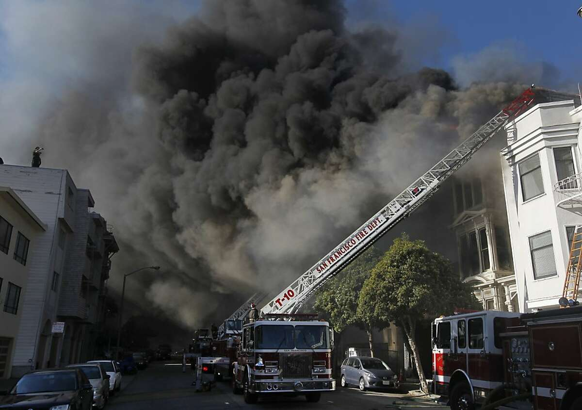 Golden Gate Avenue is darkened by a five-alarm fire that left about 60 people homeless. Only two injuries were reported.