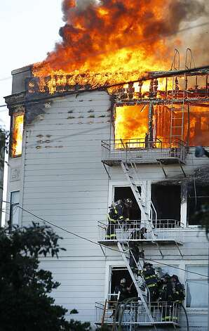 Firefighters battle a five-alarm fire at Pierce Street and Golden Gate Avenue in San Francisco, Calif. on Thursday, Dec. 22, 2011. Photo: Paul Chinn, The Chronicle
