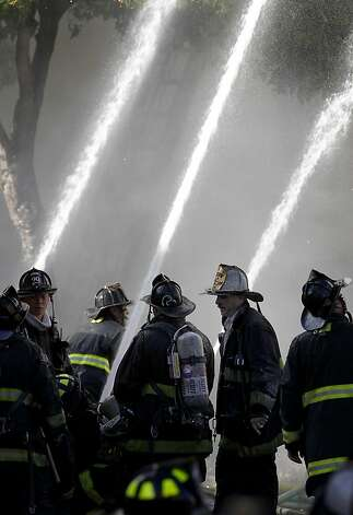 With five alarms pulled, the fire department put lots of water on the stubborn fire. A five alarm fire near the corner of Pierce and Golden Gate Avenues in San Francisco, Calif.  demolished three buildings and displaced dozens, but early on there were only reports of minor injuries Thursday December 22, 2011. Photo: Brant Ward, The Chronicle