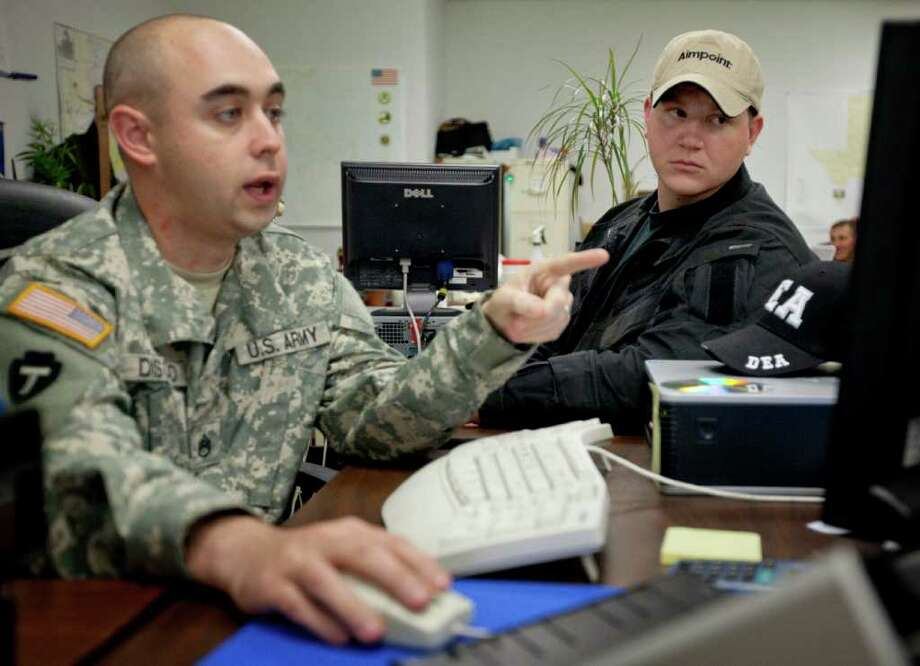 Texas Army National Guard Staff Sgt. Disoso, left, instructs Marine Cpl. Daniel Peterson on investigative procedure, Thursday, Dec. 1, 2011, in San Antonio. Photo: Darren Abate, Darren Abate/Special To The Express-News