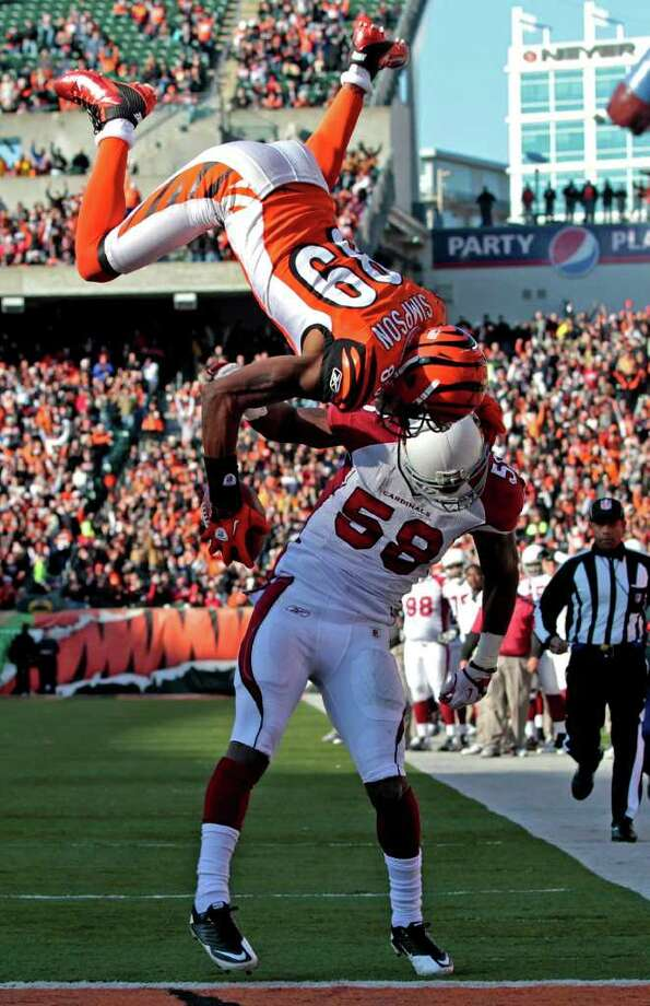 Cincinnati Bengals wide receiver Jerome Simpson (89) flips over Arizona Cardinals linebacker Daryl Washington (58) for a touchdown in the first half of an NFL football game, Saturday, Dec. 24, 2011, in Cincinnati. Photo: AP