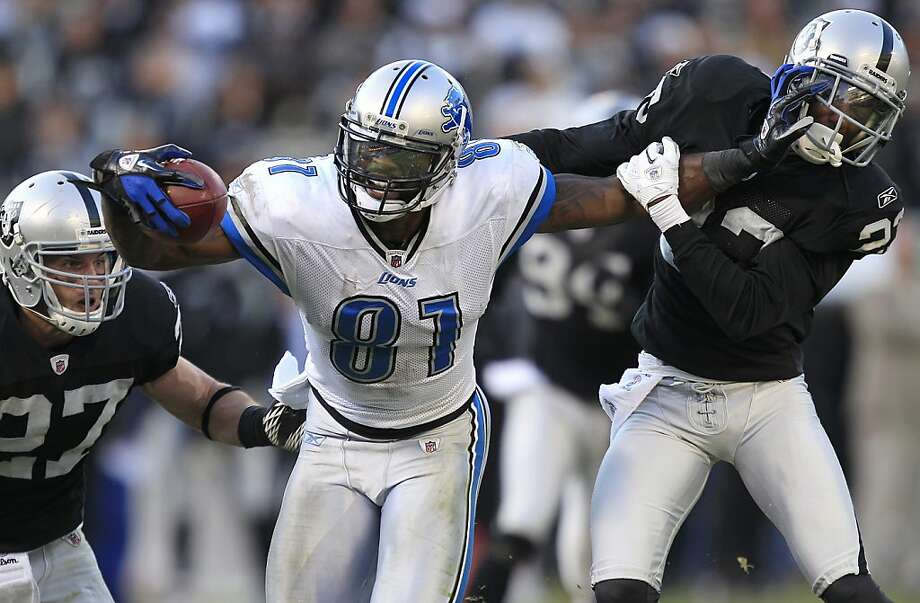Calvin Johnson, DeMarcus Van Dyke, Matt Giordano Photo: Marcio Jose Sanchez, Associated Press