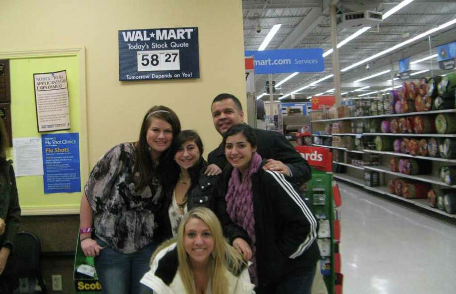 Greenwich High School students Amanda Lazarus, front, and back from left, Erin Lally and Julia Mannarino, GHS guidance counselor Luis Rivera, and student Janet Palacio at Walmart in Norwalk this past week. The students, members of the GHS Community Learning Program, collected donations to pay off holiday layaway items for a family in need. Photo: Contributed Photo