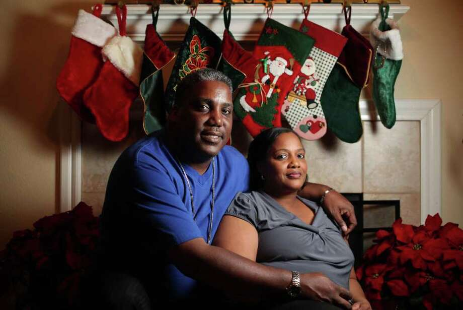Lalan and Sheila Phillips have Christmas stockings for each child in their Houston home.  He says he has 22 sons. Photo: Mayra Beltran / © 2011 Houston Chronicle