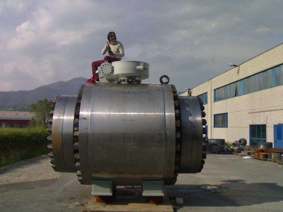 'VERY PRO BUSINESS': Fabio Brevi, an owner of OMB Valves, sits atop a 60-inch diameter ball valve at the company's headquarters in Bergamo, Italy. OMB is building a center in Stafford that is expected to generate sales of $30 million annually. Photo: NA