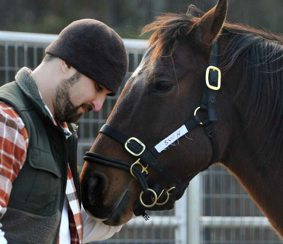 Marine veteran Michael Abbatello of Troy during a contact and connection session with the horse Traffic Chief at Bob Nevins' Saratoga War Horse program on Monday, Dec. 19, 2011 on a farm in Saratoga Springs, N.Y.  (Lori Van Buren / Times Union) Photo: Lori Van Buren