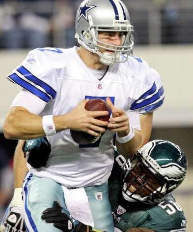 Dallas Cowboys' Stephen McGee is sacked by Philadelphia Eagles' Trent Cole during second half action Saturday Dec. 24, 2011 at Cowboys Stadium in Arlington, TX. The Eagles won 20-7. PHOTO BY EDWARD A. ORNELAS/eaornelas@express-news.net) Photo: EDWARD A. ORNELAS, Express-News / © SAN ANTONIO EXPRESS-NEWS (NFS)