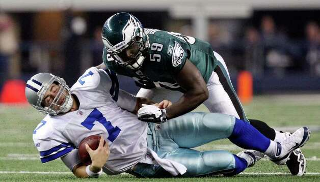 Dallas Cowboys' Stephen McGee slides under Philadelphia Eagles' Brian Rolle on a play during second half action Saturday Dec. 24, 2011 at Cowboys Stadium in Arlington, TX. The Eagles won 20-7. PHOTO BY EDWARD A. ORNELAS/eaornelas@express-news.net) Photo: EDWARD A. ORNELAS, Express-News / © SAN ANTONIO EXPRESS-NEWS (NFS)