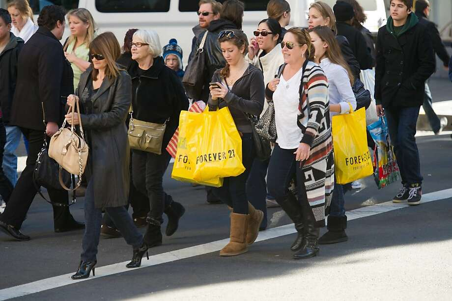 S.F. shoppers rush home with their treasures - this year, the season seems to have started. Photo: David Paul Morris, Bloomberg