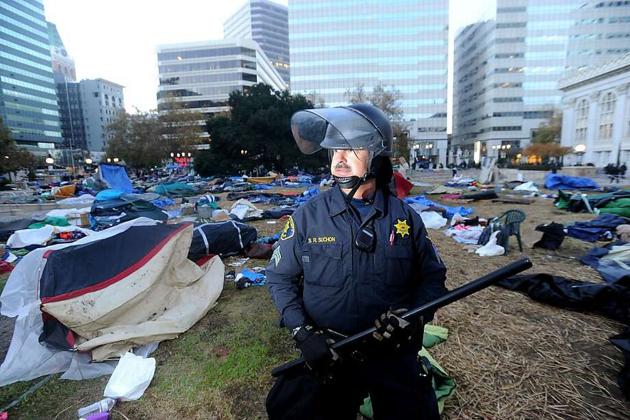 Sgt. Steve Suchon, an Alameda County sheriff's deputy, maintains a perimeter around Frank Ogawa Plaza following a police raid on Occupy Oakland on Monday, Nov. 14, 2011, in Oakland, Calif. Photo: Noah Berger, Special To The Chronicle