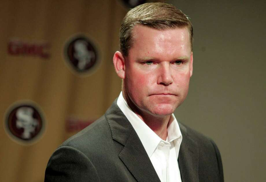 """In this Jan. 2, 2008, file photo, San Francisco 49ers general manager Scot McCloughlan is shown at a news conference in Santa Clara, Calif. The 49ers are cutting ties with  McCloughan over what has been described as a """"personal matter"""" not related to team issues. Reached Thursday, march 18, 2010, McCloughan told Fan House via text message, """"I'm fine and moving forward."""" He would not elaborate further. Photo: Patrick Tehan / AP / San Jose Mercury News"""