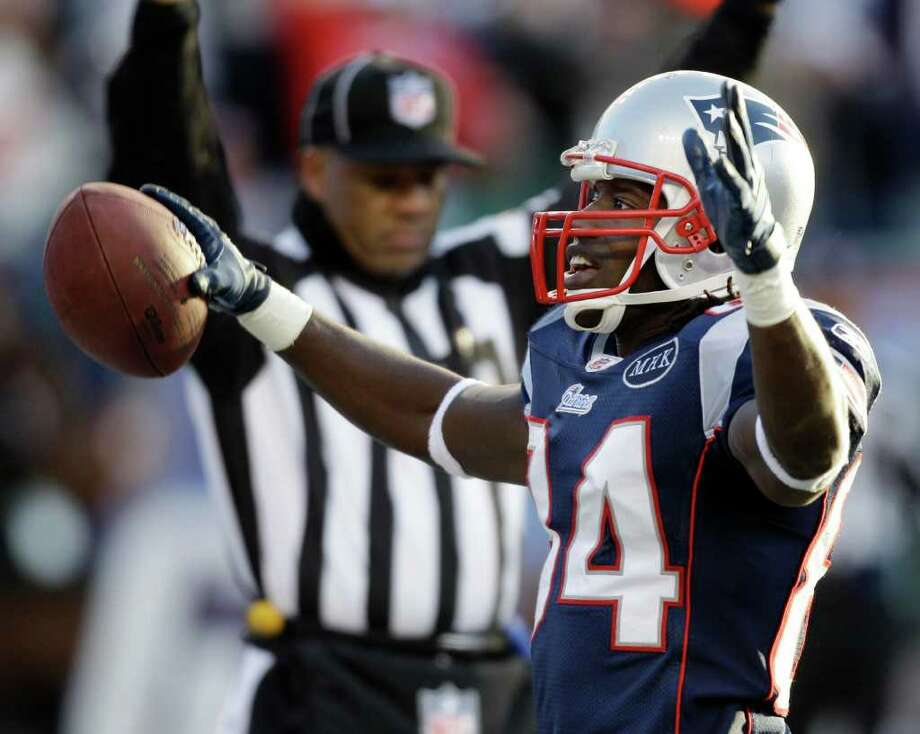 New England Patriots wide receiver Deion Branch (84) celebrates in the end zone after his touchdown against the Miami Dolphins during the third quarter of an NFL football game at Gillette Stadium in Foxborough, Mass. Saturday, Dec. 24, 2011. (AP Photo/Stephan Savoia) Photo: Stephan Savoia