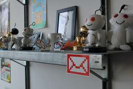 Posters, toys, and bobblehead dolls featuring Reddit.com's alien mascot  line the walls at Reddit's main offices in San Francisco.