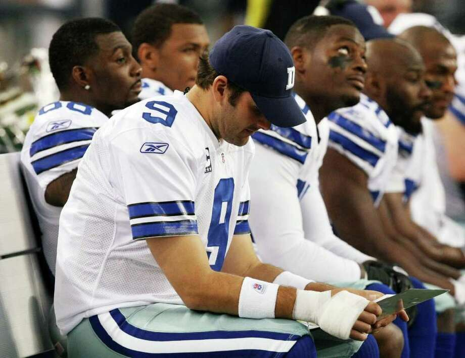 Dallas Cowboys quarterback Tony Romo (9) sits out with his throwing hand wrapped after being injured on the first series during the first half  of an NFL football game Saturday, Dec. 24, 2011, in Arlington, Texas. The Eagles won 20-7. (AP Photo/Waco Tribune Herald, Jose Yau) Photo: Jose Yau / Waco Tribune Herald 2011