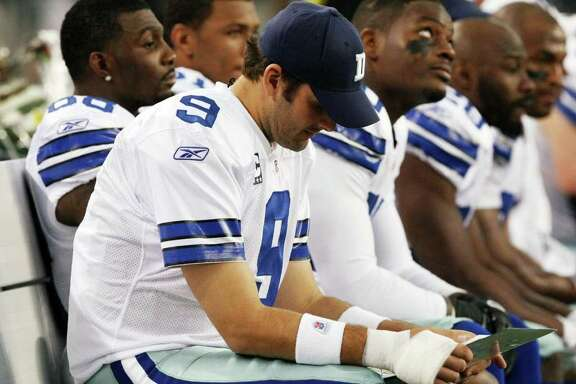 Dallas Cowboys quarterback Tony Romo (9) sits out with his throwing hand wrapped after being injured on the first series during the first half  of an NFL football game Saturday, Dec. 24, 2011, in Arlington, Texas. The Eagles won 20-7. (AP Photo/Waco Tribune Herald, Jose Yau)