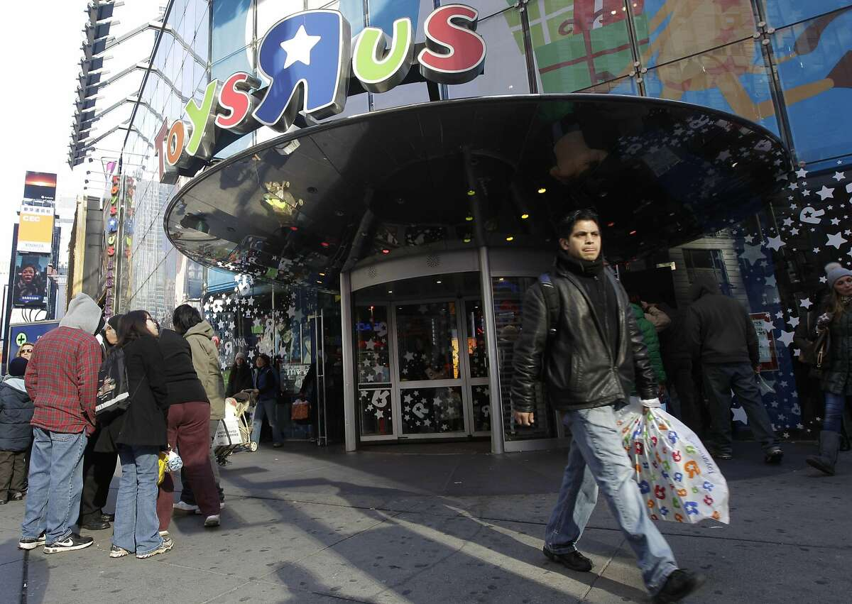 A last-minute shopper leaves the Toys R Us flagship store in New York's Times Square, Saturday, Dec. 24, 2011. As the clock counts down to Christmas Day, retailers have begun a big push to snare procrastinating shoppers searching frantically for last-minute gifts and hoping for final-weekend deals. (AP Photo/Mary Altaffer)