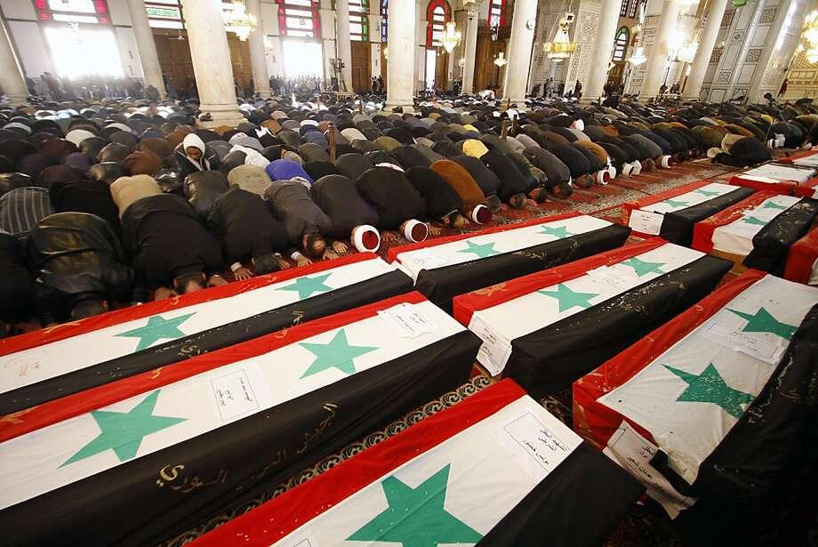 - Photo: Muzaffar Salman, Associated Press