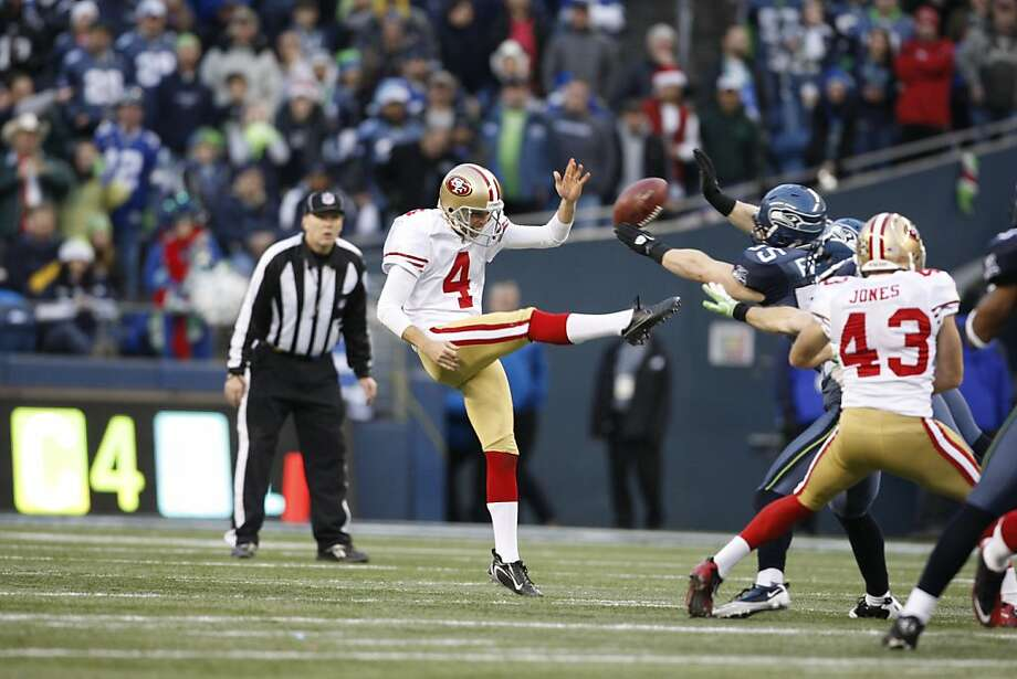 San Francisco 49ers' Andy Lee's kick is blocked by Seattle Seahawks'  Heath Farwell in the second half of an NFL football game against the Seattle Seahawks Saturday, Dec. 24, 2011, in Seattle. (AP Photo/Kevin Casey) Photo: Kevin Casey, Associated Press